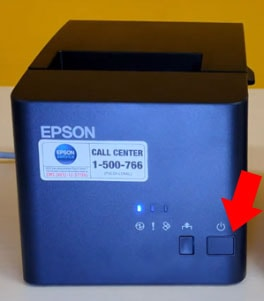 Press the Power button on the Epson TM-T82X WIFI / LAN printer until the indicator light on the printer lights up